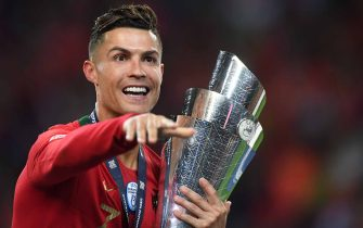 Portugal's forward Cristiano Ronaldo celebrates with the trophy after winning the UEFA Nations League final football match between Portugal and The Netherlands at the Dragao Stadium in Porto on June 9, 2019. (Photo by PATRICIA DE MELO MOREIRA / AFP)        (Photo credit should read PATRICIA DE MELO MOREIRA/AFP via Getty Images)