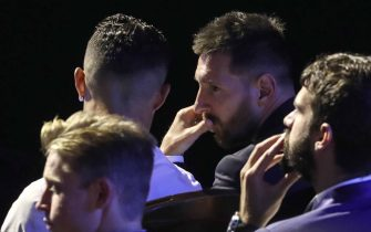 TOPSHOT - Argentine forward Lionel Messi (R) speaks with Portuguese forward Cristiano Ronaldo (L) during the UEFA Champions League football group stage draw ceremony in Monaco on August 29, 2019. (Photo by Valery HACHE / AFP)        (Photo credit should read VALERY HACHE/AFP via Getty Images)