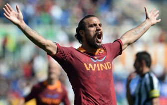 AS Roma's Argentinian forward Pablo Daniel Osvaldo celebrates after scoring a goal during an Italian Serie A football match between AS Roma and Siena on April 28, 2013 at the Olympic stadium in Rome.  AFP PHOTO / GABRIEL BOUYS        (Photo credit should read GABRIEL BOUYS/AFP via Getty Images)