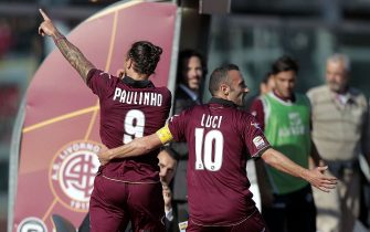 LIVORNO, ITALY - NOVEMBER 03:  Paulinho (L) celebrates with Andrea Luci of AS Livorno Calcio after scoring the opening goal during the Serie A match between AS Livorno Calcio and Atalanta BC at Stadio Armando Picchi on November 3, 2013 in Livorno, Italy.  (Photo by Gabriele Maltinti/Getty Images)