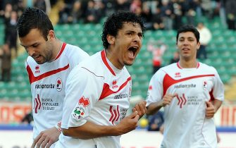 BARI, ITALY - JANUARY 06:  Paulo Barreto and Riccardo Megiorini of AS Bari celebrate the opening goal during the Serie A match between AS Bari and Udinese Calcio at Stadio San Nicola on January 6, 2010 in Bari, Italy.  (Photo by Giuseppe Bellini/Getty Images)