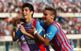 CATANIA, ITALY - OCTOBER 06: Pablo Barrientos (L) and Gonzalo Bergessio of Catania celebrate the opening goal during the Serie A match between Calcio Catania and Genoa CFC at Stadio Angelo Massimino on October 6, 2013 in Catania, Italy. (Photo by Maurizio Lagana/Getty Images)