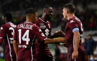 TURIN, ITALY - SEPTEMBER 02: Nicolas Nkoulou (C) of Torino FC celebrates after scoring the opening goal with teammates Andrea Belotti and Iago Falque during the Serie A match between Torino FC and SPAL at Stadio Olimpico di Torino on September 2, 2018 in Turin, Italy.  (Photo by Valerio Pennicino/Getty Images)