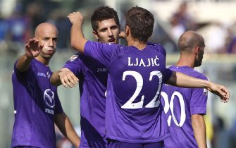 FLORENCE, ITALY - SEPTEMBER 16:  Stevan Jovetic (L) of ACF Fiorentina celebrates with his team-mates Adem Ljajic (R) and Gonzalo Rodriguez after scoring the opening goal during the Serie A match between ACF Fiorentina and Calcio Catania at Stadio Artemio Franchi on September 16, 2012 in Florence, Italy.  (Photo by Marco Luzzani/Getty Images)