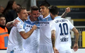 Lazios Sergej Milinkovic-Savic  (2L) celebrates with his teammates Ciro Immobile (L) ;Joaquin Correa and Luis Alberto (R)  after scoring the 0-1 goal  during the Italian serie A soccer match between FC Inter and SS Lazio at Giuseppe Meazza stadium in Milan 31  March  2019.ANSA / MATTEO BAZZI