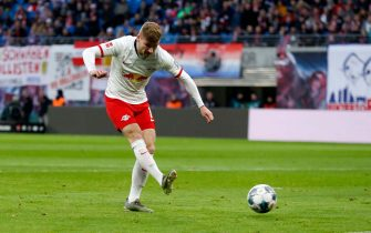 Leipzig's German forward Timo Werner shoots to score during the German first division Bundesliga football match RB Leipzig v Hoffenheim in Leipzig on December 7, 2019. (Photo by Odd ANDERSEN / AFP) / DFL REGULATIONS PROHIBIT ANY USE OF PHOTOGRAPHS AS IMAGE SEQUENCES AND/OR QUASI-VIDEO (Photo by ODD ANDERSEN/AFP via Getty Images)