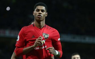 MANCHESTER, ENGLAND - JANUARY 11: Marcus Rashford of Manchester United celebrates scoring their second goal during the Premier League match between Manchester United and Norwich City at Old Trafford on January 11, 2020 in Manchester, United Kingdom. (Photo by Tom Purslow/Manchester United via Getty Images)