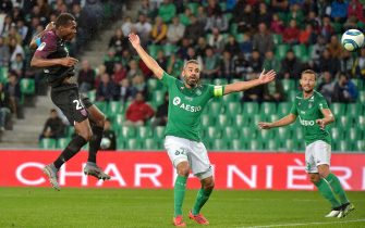 Metz's Senegalese forward Habib Diallo (L) heads the ball and scores next to Saint-Etienne's French defender Loic Perrin (R) during the French L1 football match between AS Saint-Etienne and FC Metz at the Geoffroy Guichard Stadium in Saint-Etienne, central France on September 25, 2019. (Photo by ROMAIN LAFABREGUE / AFP)        (Photo credit should read ROMAIN LAFABREGUE/AFP via Getty Images)
