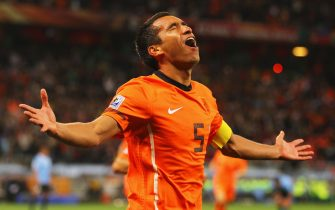 CAPE TOWN, SOUTH AFRICA - JULY 06:  Giovanni Van Bronckhorst of the Netherlands celebrates scoring the opening goal during the 2010 FIFA World Cup South Africa Semi Final match between Uruguay and the Netherlands at Green Point Stadium on July 6, 2010 in Cape Town, South Africa.  (Photo by Lars Baron/Getty Images)