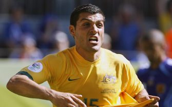 Kaiserslautern, GERMANY:  Australian forward John Aloisi celebrates his goal against Japan in their first round Group F World Cup football match at Kaiserslautern's Fritz-Walter Stadium, 12 June 2006. Aloisi scored the team's third goal as Australia came from behind to win the match 3-1.            AFP PHOTO / TORSTEN BLACKWOOD  (Photo credit should read TORSTEN BLACKWOOD/AFP via Getty Images)