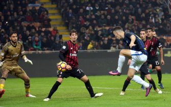 Fc Inter midfielder Ivan Perisic scores the goal of 2 to 2 during the Italian serie A soccer match between Ac Milan and Fc Inter  at Giuseppe Meazza stadium in Milan, 20 November  2016. ANSA / MATTEO BAZZI