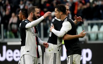 TURIN, ITALY - DECEMBER 15: Cristiano Ronaldo of Juventus celebrates after his goal 2-0 with his team mates Leonardo Bonucci and Gonzalo Higuain during the Serie A match between Juventus and Udinese Calcio at Allianz Stadium on December 15, 2019 in Turin, Italy. (Photo by MB Media/Getty Images)