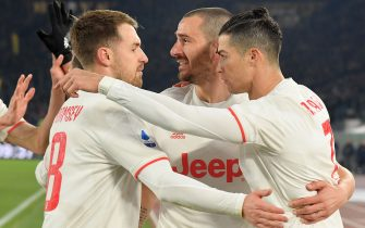 Juventus' Portuguese forward Cristiano Ronaldo (R) celebrates with Juventus' Welsh midfielder Aaron Ramsey (L) and Juventus' Italian defender Leonardo Bonucci after scoring a penalty during the Italian Serie A football match AS Roma vs Juventus on January 12, 2020 at the Olympic stadium in Rome. (Photo by Tiziana FABI / AFP) (Photo by TIZIANA FABI/AFP via Getty Images)