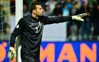 Goalkeeper Samir Handanovic of Slovenia shouts during a FIFA World Cup 2014 qualifying football match between Slovenia and Norway in Maribor, Slovenia on October 11, 2013.AFP PHOTO / Jure Makovec        (Photo credit should read Jure Makovec/AFP via Getty Images)