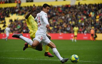 Lille's French midfileder Benjamin Andre (R) vies with Nantes' French midfielder Abdoul Kader Bamba (L) during the French L1 football match between FC Nantes and Lille (LOSC), at La Beaujoire Stadium, western France, on March 1, 2020. (Photo by JEAN-FRANCOIS MONIER / AFP) (Photo by JEAN-FRANCOIS MONIER/AFP via Getty Images)