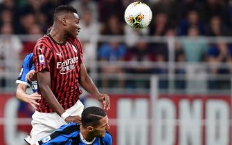 AC Milan's Portuguese forward Rafael Leao (L) and Inter Milan's Italian defender Danilo D'Ambrosio go for a header during the Italian Serie A football match AC Milan vs Inter Milan on September 21, 2019 at the San Siro stadium in Milan. (Photo by Miguel MEDINA / AFP)        (Photo credit should read MIGUEL MEDINA/AFP via Getty Images)