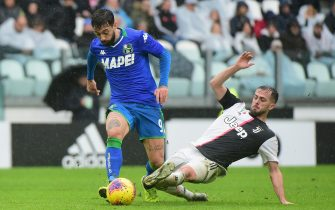TURIN, ITALY - DECEMBER 01:  (L) Francesco Caputo of US Sassuolo competes for the ball with (R)Miralem Pjanic of Juventus during the Serie A match between Juventus and US Sassuolo at  on December 1, 2019 in Turin, Italy.  (Photo by Pier Marco Tacca Getty Images)