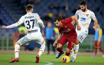 ROME, ITALY - FEBRUARY 23: Henrij Mjitarián of AS Roma Competes for the ball with Yevhen Shakhov and Zan Majer of US Lecce  ,during the Serie A match between AS Roma and  US Lecce at Stadio Olimpico on February 23, 2020 in Rome, Italy. (Photo by MB Media/Getty Images)