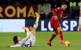 ROME, ITALY - FEBRUARY 23: Lorenzo Pellegrini of AS Roma competes for the ball with Jacopo Petriccione of US Lecce during the Serie A match between AS Roma and  US Lecce at Stadio Olimpico on February 23, 2020 in Rome, Italy. (Photo by MB Media/Getty Images)