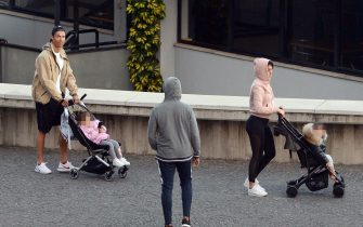 Cristiano Ronaldo (L) and his partner Georgina Rodriguez push two strollers as they have a walk with their children in Funchal on March 28, 2020. (Photo by HELDER SANTOS / AFP) (Photo by HELDER SANTOS/AFP via Getty Images)