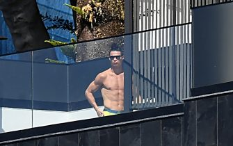 Portugal and Juventus' Portuguese forward Cristiano Ronaldo sunbathes at his home in Funchal on March 16, 2020. - Ronaldo has been in quarantine in Madeira for several days but is not showing any symptoms of the coronavirus contracted by a Juventus teammate, local authorities in Portugal said. (Photo by RUI SILVA / AFP) / The erroneous date appearing in the metadata of this photo by RUI SILVA has been modified in AFP systems in the following manner: [on March 16, 2020] instead of [on March 17, 2020]. Please immediately remove the erroneous mention[s] from all your online services and delete it (them) from your servers. If you have been authorized by AFP to distribute it (them) to third parties, please ensure that the same actions are carried out by them. Failure to promptly comply with these instructions will entail liability on your part for any continued or post notification usage. Therefore we thank you very much for all your attention and prompt action. We are sorry for the inconvenience this notification may cause and remain at your disposal for any further information you may require. (Photo by RUI SILVA/AFP via Getty Images)