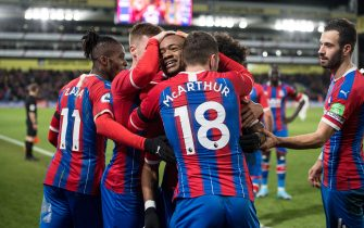LONDON, ENGLAND - DECEMBER 26: Jordan Ayew of Crystal Palace celebrate with hes team mates James McArthur and James McCarthy after scoring goal during the Premier League match between Crystal Palace and West Ham United at Selhurst Park on December 26, 2019 in London, United Kingdom. (Photo by Sebastian Frej/MB Media/Getty Images)