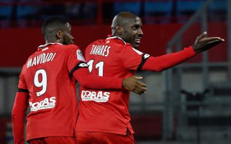 Dijon's Cap Verde forward Julio Tavares (R) celebrates after scoring a goal during  the French L1 football match between Dijon (DFCO) and Nantes (FCN), at the Gaston Gerard stadium in Dijon on February 8, 2020. (Photo by JEAN-PHILIPPE KSIAZEK / AFP) (Photo by JEAN-PHILIPPE KSIAZEK/AFP via Getty Images)