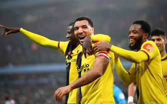 BIRMINGHAM, ENGLAND - JANUARY 21: Troy Deeney of Watford celebrates after scoring his team's first goal with Nathaniel Chalobah and  Abdoulaye Doucoure of Watford during the Premier League match between Aston Villa and Watford FC at Villa Park on January 21, 2020 in Birmingham, United Kingdom. (Photo by Clive Mason/Getty Images)