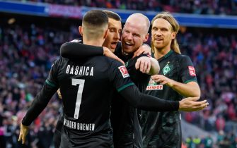MUNICH, GERMANY - DECEMBER 14: (BILD ZEITUNG OUT) Milot Rashica of SV Werder Bremen celebrates after scoring his team's first goal with team mates during the Bundesliga match between FC Bayern Muenchen and SV Werder Bremen at Allianz Arena on December 14, 2019 in Munich, Germany. (Photo by TF-Images/Getty Images)