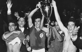 2nd June 1961:  The players of the portuguese football club, Benfica, celebrate with the European cup trophy after their 3-2 victory over Barcelona in the European Cup final at the Wankdrof Stadium in Berne, Switzerland. From left to right are : R. Neto, Captain Aguas, Cavem and Augusto.  (Photo by Central Press/Getty Images)