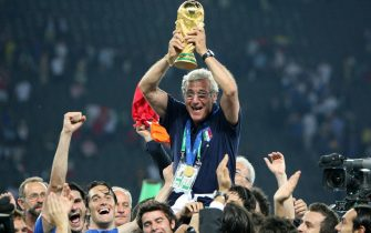 Italian national coach Marcello Lippi celebrates with the World Cup Trophy in his hands at the end of the final of the 2006 FIFA World Cup between Italy and France at the Olympic Stadium in Berlin, Germany, Sunday 09 July 2006. ANSA/Kay Nietfeld