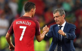 epa05400468 Portugal's head coach Fernando Santos (R) celebrates with Cristiano Ronaldo (L) after the penalty shootout of the UEFA EURO 2016 quarter final match between Poland and Portugal at Stade Velodrome in Marseille, France, 30 June 2016. Portugal won 5-3 on penalties.(RESTRICTIONS APPLY: For editorial news reporting purposes only. Not used for commercial or marketing purposes without prior written approval of UEFA. Images must appear as still images and must not emulate match action video footage. Photographs published in online publications (whether via the Internet or otherwise) shall have an interval of at least 20 seconds between the posting.)  EPA/PETER POWELL   EDITORIAL USE ONLY