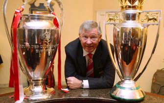 MOSCOW, RUSSIA - MAY 22: (EXCLUSIVE ACCESS - MINIMUM PRICING OF 250GBP OR LOCAL EQUIVALENT) Sir Alex Ferguson of Manchester United poses with the UEFA Champions League trophy and the FA Barclays Premier League trophy after winning the UEFA Champions League Final match between Manchester United and Chelsea at Luzhniki Stadium on May 22 2008 in Moscow, Russia. (Photo by John Peters/Manchester United via Getty Images)
