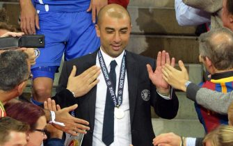 Chelsea's head coach Roberto Di Matteo (C) is congratulated after the UEFA Champions League soccer final between FC Bayern Munich and Chelsea FC in Munich, Germany, 19 May 2012.ANSA/MARCUS BRANDT