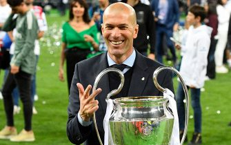 TOPSHOT - Real Madrid's French coach Zinedine Zidane poses with the trophy after winning  the UEFA Champions League final football match between Liverpool and Real Madrid at the Olympic Stadium in Kiev, Ukraine, on May 26, 2018. (Photo by GENYA SAVILOV / AFP)        (Photo credit should read GENYA SAVILOV/AFP via Getty Images)
