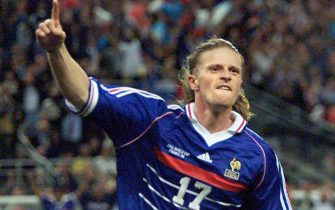 SDF129-19980712-SAINT-DENIS, FRANCE: French Emmanuel Petit jubilates after scoring the 3rd goal for his team, 12 July 1998 at the Stade de France in Saint-Denis, near Paris,  during the 1998 Soccer World Cup final match between Brazil and France. France won the title for the first time, beating Brazil 3-0. (ELECTRONIC IMAGE)    EPA PHOTO      AFP/ANTONIO SCORZA