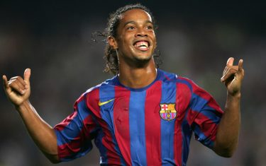 Barcelona, SPAIN:  FC Barcelona's Brazilian Ronaldinho celebrates the second goal against Real Sociedad during their Spanish League football match at the Camp Nou stadium in Barcelona, 30 October 2005. AFP PHOTO/LLUIS GENE  (Photo credit should read LLUIS GENE/AFP/Getty Images)