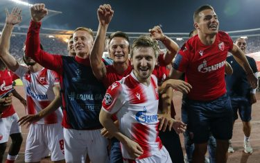 BELGRADE, SERBIA - AUGUST 27: Radovan Pankov (L) Njegos Petrovic (C) and Marko Marin (R) of Crvena Zvezda celebrate after winning the UEFA Champions League Play Off Second Leg match between Crvena Zvezda and Young Boys at stadium Rajko Mitic on August 27, 2019 in Belgrade, Serbia. (Photo by Srdjan Stevanovic/Getty Images)