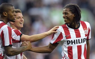 Jeremain Lens (L) and Dries Mertens (2nd L) of PSV Eindhoven congratulate teammate Georginio Wijnaldum (R) on his goal against SV Ried during their Europa League play-off match in Eindhoven, on August 25, 2011. AFP PHOTO / ANP / MARCEL VAN HOORN  netherlands out - belgium out (Photo credit should read MARCEL VAN HOORN/AFP/Getty Images)