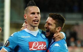 Napoli's midfielder Marek Hamsik, left, jubilates with the teammates Dries Mertens after scoring the 1-0 goal during the UEFA Europa League soccer match between SSC Napoli and Villarreal CF at the San Paolo stadium, Naples, Italy, 25 February 2016. ANSA / CIRO FUSCO