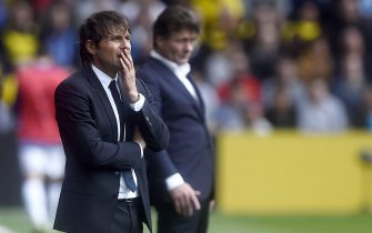 epa05502134 Chelsea manager Antonio Conte (left) during the Premier League soccer match between Watford and Chelsea at Vicarage Road Stadium in London, Britain, 20 August 2016.  EPA/WILL OLIVER EDITORIAL USE ONLY. No use with unauthorized audio, video, data, fixture lists, club/league logos or 'live' service. Online in-match use limited to 75 images, no video emulation. No use in betting, games or single club/league/player publications