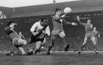 A tense moment for Liverpool players Tommy Smith (left) and Geoff Strong (second from right) as Inter-Milan player Mario Corso lunges in with a header during an attack by the Italian side in a semi-final, first leg match at Anfield, 5th May 1965. Liverpool won the match 3-1. (Photo by Central Press/Hulton Archive/Getty Images)