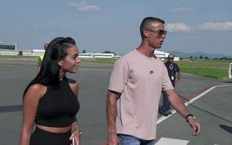 New Juventus soccer player Cristiano Ronaldo (R) of Portugal accompained by his girlfriend Georgina Rodriguez (L)  arrives at Caselle airport in Turin, Italy, 15 July 2018. ANSA/ ALESSANDRO DI MARCO