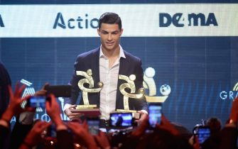 MILAN, ITALY - DECEMBER 02:  Cristiano Ronaldo receives the best soccer player during the 'Oscar del Calcio AIC' Italian Football Awards on December 2, 2019 in Milan, Italy.  (Photo by Pier Marco Tacca/Getty Images)