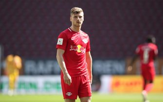 epa08513379 Timo Werner of Leipzig looks on during the Bundesliga match between FC Augsburg and RB Leipzig at WWK-Arena in Augsburg, Germany, 27 June 2020.  EPA/Alexander Hassenstein / POOL DFL regulations prohibit any use of photographs as image sequences and/or quasi-video.