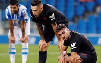 epa08550815 Sevilla's Lucas Ocampos (C) and Munir (R) react during the Spanish LaLiga soccer match between Real Sociedad and Sevilla FC held at Reale Arena Stadium, in San Sebastian, Spain, 16 July 2020.  EPA/Juan Herrero