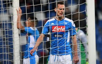 REGGIO NELL'EMILIA, ITALY - DECEMBER 22: Arkadiusz Milik of SSC Napoli  shows his dejection during the Serie A match between US Sassuolo and SSC Napoli at Mapei Stadium - Citta del Tricolore on December 22, 2019 in Reggio nell'Emilia, Italy  (Photo by Alessandro Sabattini/Getty Images)