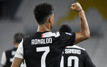 TURIN, ITALY - JULY 20: Cristiano Ronaldo of Juventus FC celebrates after scoring the second goal of his team  during the Serie A match between Juventus and  SS Lazio at  on July 20, 2020 in Turin, Italy. (Photo by Stefano Guidi/Getty Images)