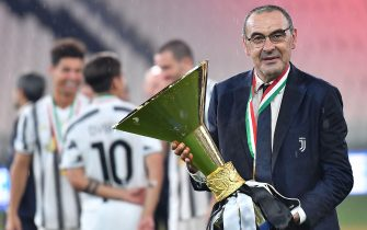Head coach Maurizio Sarri jubilate with the cup during the celebrations for the Juventus' victory of the 9th consecutive Italian championship (scudetto) at Allianz Stadium in Turin, Italy, 01 August 2020. ANSA/ALESSANDRO DI MARCO