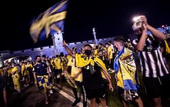 epa08542730 Cadiz supporters celebrate their team will play at Spanish First Division next season, at the Puertas de la Tierra fountain in Cadiz, Spain, 12 July 2020.  EPA/Roman Rios
